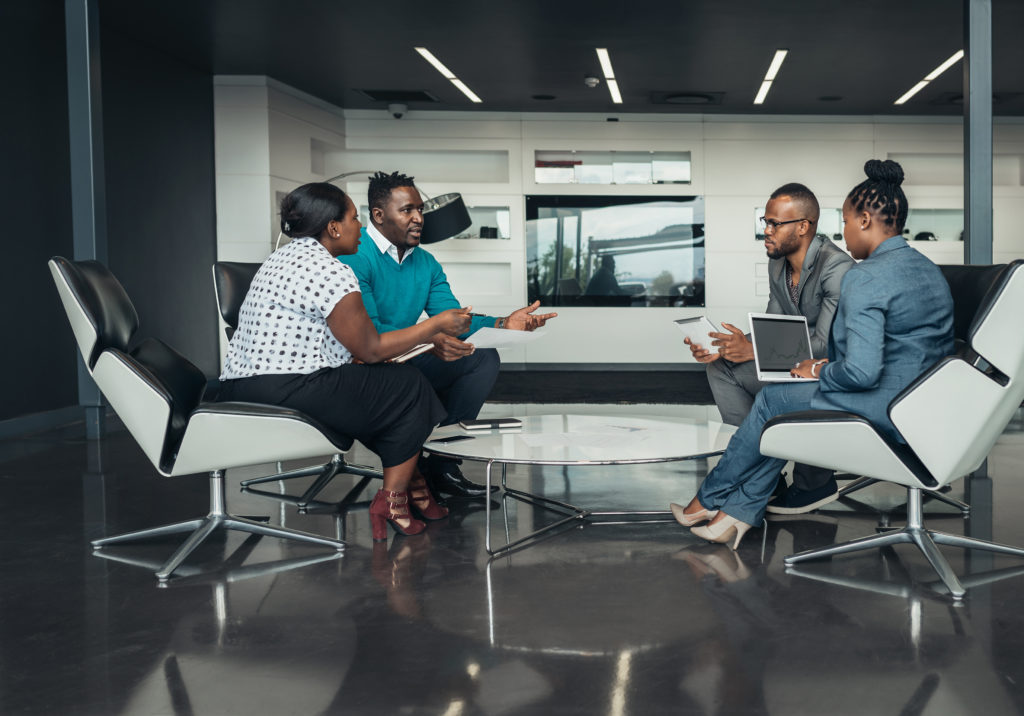 Team african bussines people sitting modern office